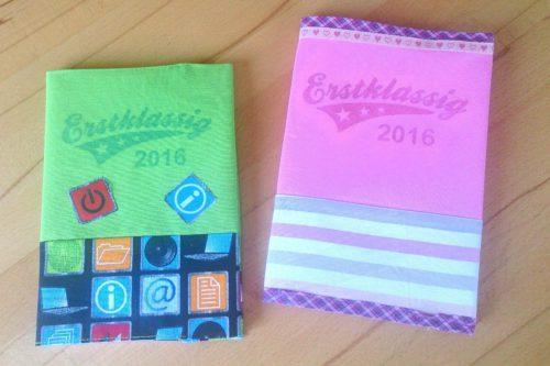 Hefteinband selbstgenäht: 2 fertige Einbände, einer in rosa und einer in grün gehalten. Frontansicht